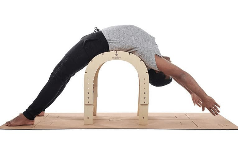 Stretching with an innovative yoga back bender