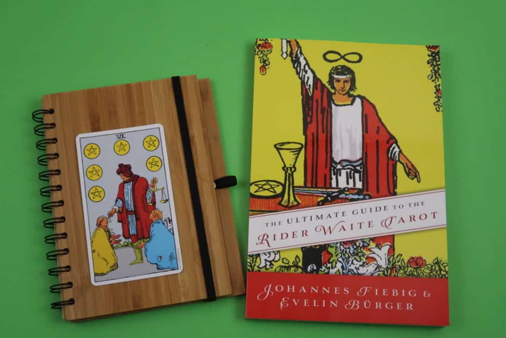 Six of Pentacles Upright meaning