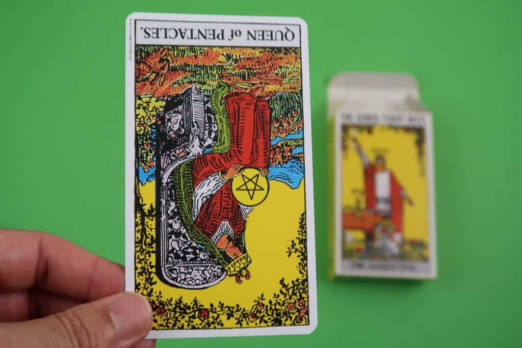 The Queen of Pentacles reversed psychic reading today