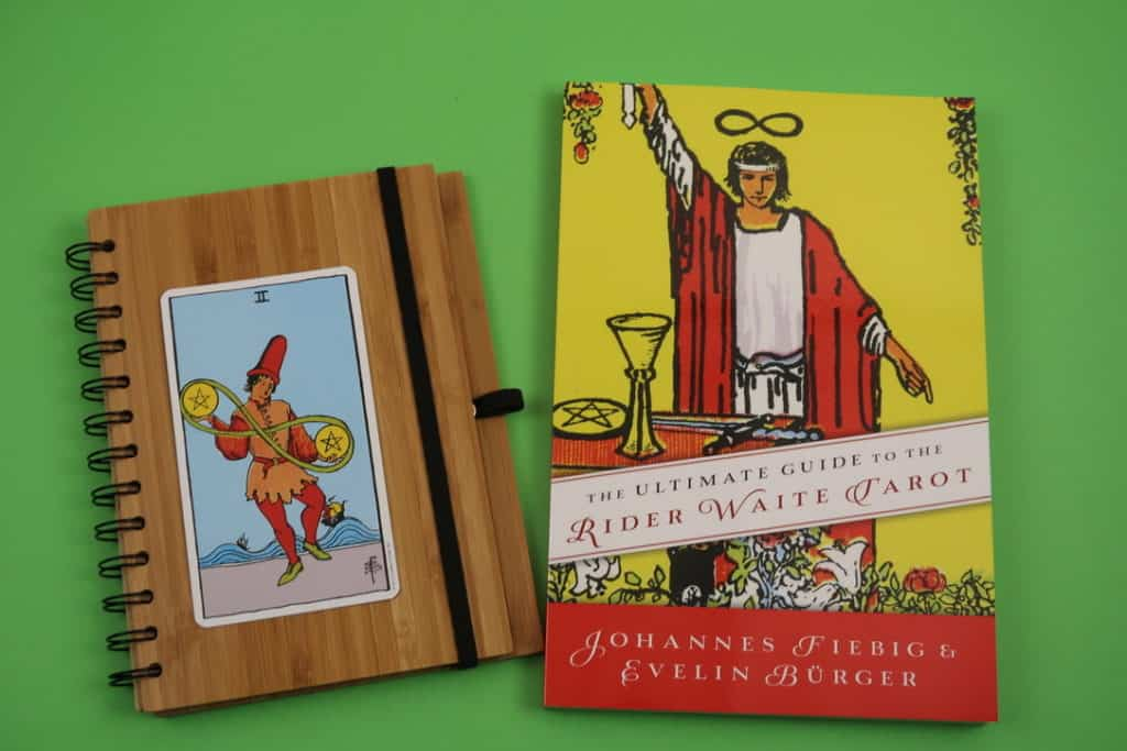 The Two of Pentacles Upright meaning