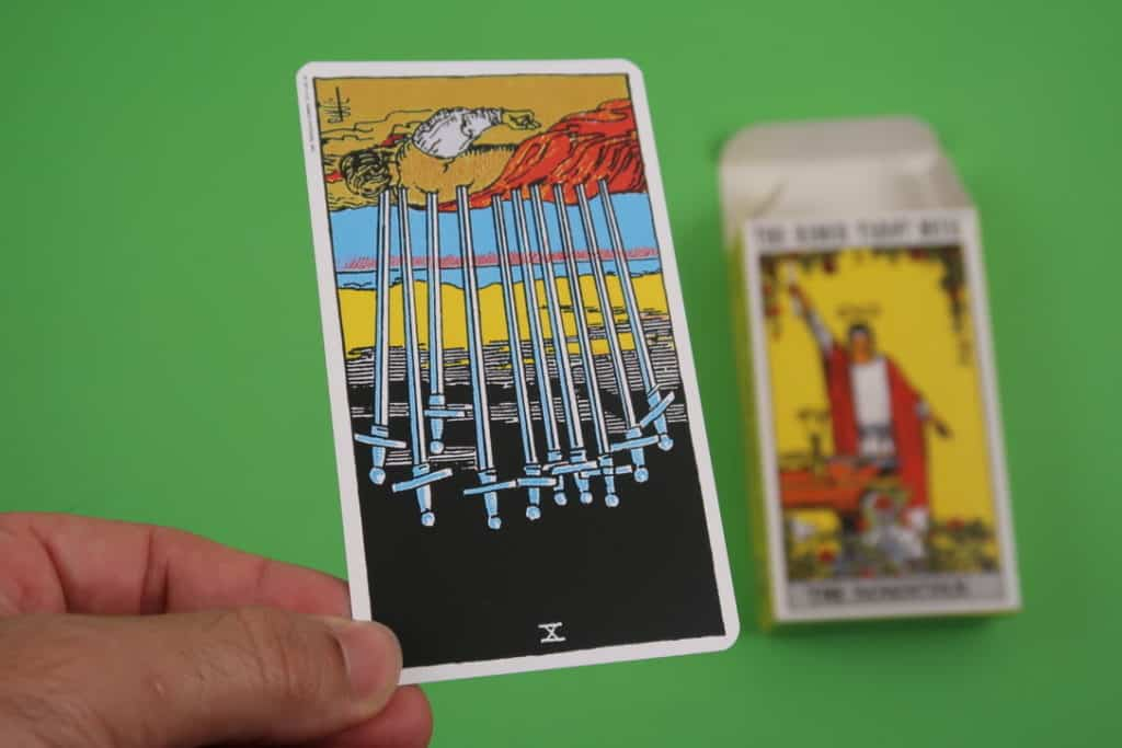 Our psychic reading of The Ten of Swords Reversed