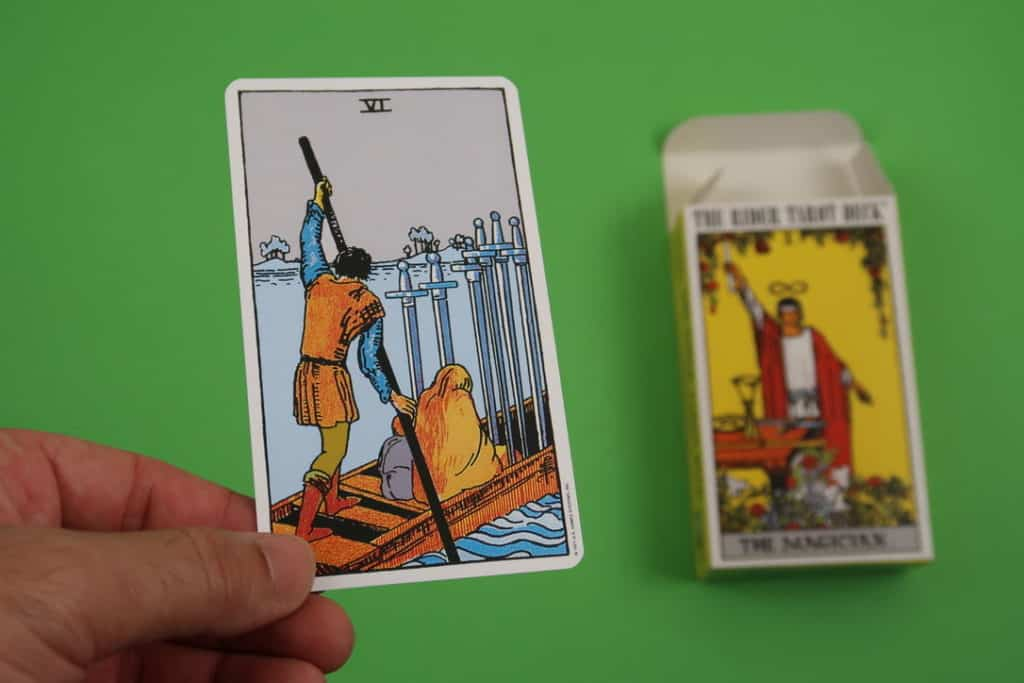 The Six of Swords upright psychic reading