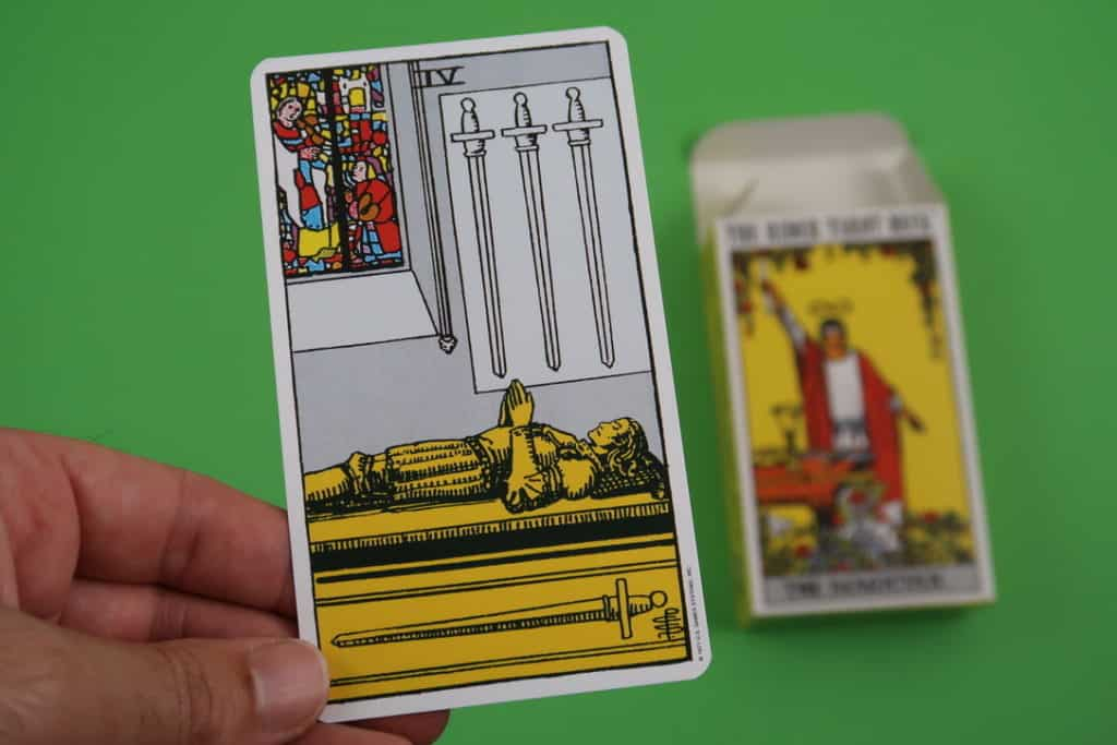 A psychic reading of The Four of Swords Upright with the Rider-Waite series.