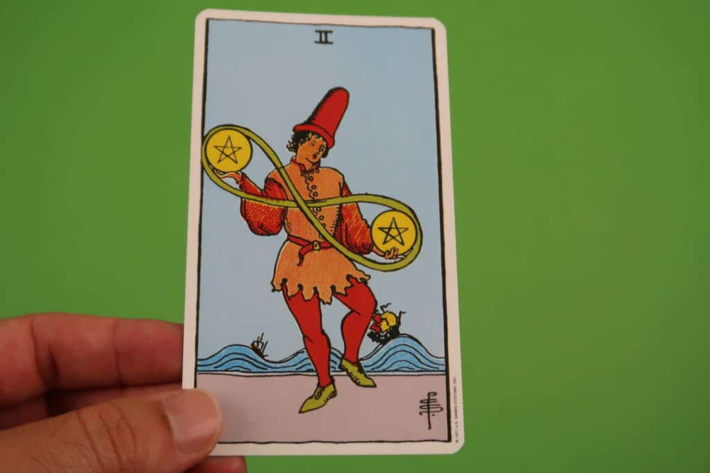 Psychic reading of The Two of Pentacles Upright